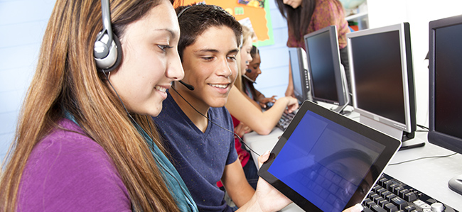 Education: High school students in computer lab with teacher.
